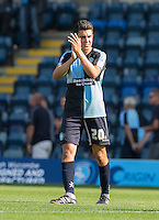 Luke O'Nien of Wycombe Wanderers applauds the supporters after the 3-0 win on his debut during the Sky Bet League 2 match between Wycombe Wanderers and York City at Adams Park, High Wycombe, England on 8 August 2015. Photo by Andy Rowland.