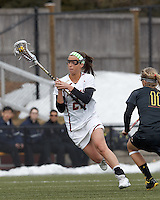 Boston College midfielder Cali Ceglarski (23) brings the ball forward. .University of Maryland (black) defeated Boston College (white), 13-5, on the Newton Campus Lacrosse Field at Boston College, on March 16, 2013.