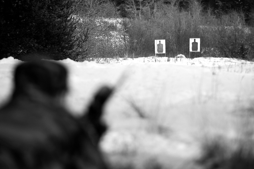 Kevin Korsund views a target through the scope of his rifle during a winter weather training session on Bureau of Land Management land near Priest Lake, Idaho.