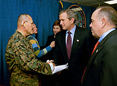 United States President George W. Bush and Laura Bush attend the U.S. Citizenship Ceremony for Marine Corps Mastery Gunnery Sargeant Guadalupe Denogean of Tucson, Arizona, at the National Naval Medical Center in Bethesda, Maryland,  Friday, April 11, 2003.  Pictured at far right, Eduardo Aguirre, Jr., Acting Director of the Bureau of Citizenship and Immigration Services, who conducted the ceremony. <br /> Mandatory Credit: Eric Draper / White House via CNP