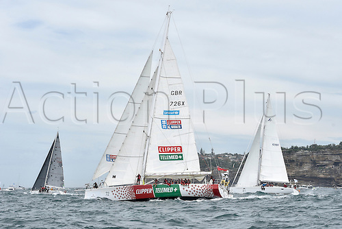 26.12.2015 Sydney, Australia. Rolex Sydney to Hobart Yacht race 2015. The rest of the fleet heads out to sea during the start of the 629 nautical mile race from Sydney to Hobart on Sydney Harbour.Clipper Telemed+ from Great Britain type Clipper 70.