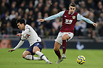 Burnley's Matthew Lowton avoids a challenged from Tottenham's Son Heung-min during the Premier League match at the Tottenham Hotspur Stadium, London. Picture date: 7th December 2019. Picture credit should read: Paul Terry/Sportimage