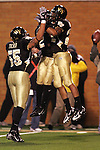 4 November 2006: Wake Forest's Josh Gattis (right) accepts congratulations from teammates Alphonso Smith (center) and Jyles Tucker (55) after intercepting a second quarter Boston College pass in the end zone for a touchback. Wake Forest defeated Boston College 21-14 at Groves Stadium in Winston-Salem, North Carolina in an Atlantic Coast Conference college football game.