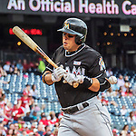 14 May 2016: Miami Marlins third baseman Martin Prado is hit by a pitch in the 5th inning during the first game of a double-header against the Washington Nationals at Nationals Park in Washington, DC. The Nationals defeated the Marlins 6-4 in the afternoon matchup.  Mandatory Credit: Ed Wolfstein Photo *** RAW (NEF) Image File Available ***