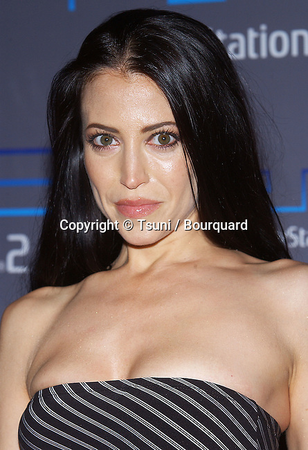 "Leslie Bega (Soprano) arriving at the Playstation 2 Party ""The Underworld"" at the Belasco Theatre in Los Angeles. May 11, 2004."