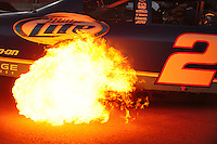 Feb 29, 2008; Las Vegas, NV, USA; Flames come from the exhaust of the car of NASCAR Sprint Cup Series driver Kurt Busch during qualifying for the UAW Dodge 400 at Las Vegas Motor Speedway. Mandatory Credit: Mark J. Rebilas-US PRESSWIRE