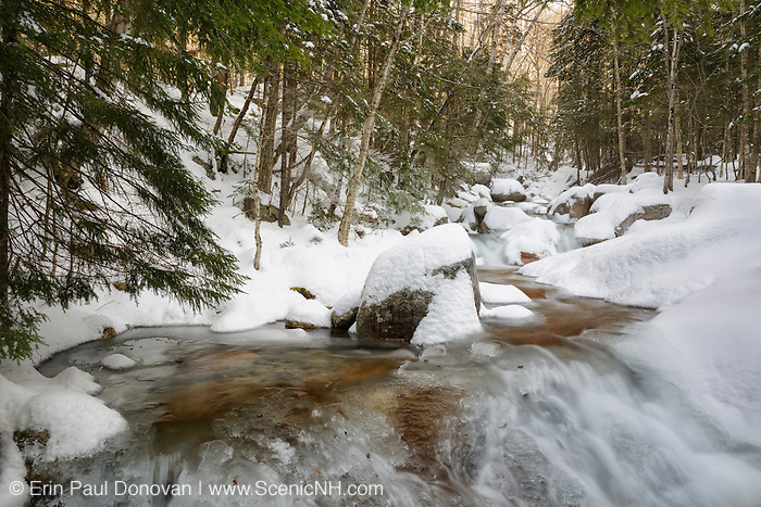 Flume Brook covered in snow at Flume Gorge at Franconia Notch State Park in Lincoln, New Hampshire.