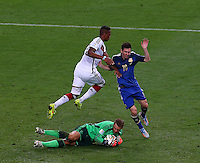 Lionel Messi of Argentina is crowded out by Germany goalkeeper Manuel Neuer and Jerome Boateng