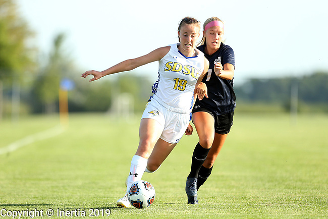 BROOKINGS, SD - AUGUST 23: Maya Hansen #13 from South Dakota State University pushes the ball in front of Megan Astle #7 from Utah State during their match Friday evening at Fischback Soccer field in Brookings. (Photo by Dave Eggen/Inertia)