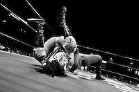 "A female Lucha libre wrestler pins down her rival during a fight at Arena Mexico in Mexico City, Mexico, 26 April 2011. Lucha libre, literally ""free fight"" in Spanish, is a unique Mexican sporting event and cultural phenomenon. Based on aerial acrobatics, rapid holds and the use of mysterious masks, Lucha libre features the wrestlers as fictional characters (Good vs. Evil). Women wrestlers, known as luchadoras, often wear bright shiny leotards, black pantyhose or other provocative costumes. Given the popularity of Lucha libre in Mexico, many wrestlers have reached the cult status, showing up in movies or TV shows. However, almost all female fighters are amateur part-time wrestlers or housewives. Passing through the dirty remote areas in the peripheries, listening to the obscene screams from the mainly male audience, these no-name luchadoras fight straight on the street and charge about 10 US dollars for a show. Still, most of the young luchadoras train hard and wrestle virtually anywhere dreaming to escape from the poverty and to become a star worshipped by the modern Mexican society."