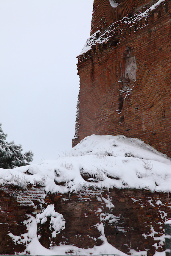 Rome, Villa Gordiani:  A view of the ancient Tor de&rsquo; Schiavi (the Tower of the Slaves), in villa Gordiani, on the Prenestina road.  This is a peculiar view, since it is taken after a snowing night and the ruins are covered by snow (February 2012).<br /> <br /> You can download this file for (E&amp;PU) only, but you can find in the collection the same one available instead for (Adv).
