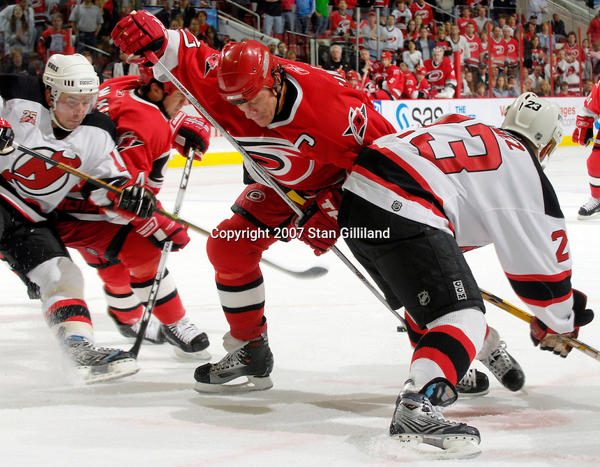 Carolina Hurricanes' Rod Brind'Amour battles with the New Jersey Devils' Scott Gomez during a faceoff Thursday, March 15, 2007 at the RBC Center in Raleigh, NC. New Jersey won 3-2.