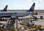 Passengers people boarding a Ryanair plane flight Faro airport, Portugal