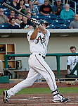 Reno Aces Ryan Wheeler rips a RBI double in the first inning against the Fresno Grizzlies during their game on Thursday night June 28, 2012 at Aces Ballpark in Reno NV.