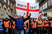 English Defence League (EDL) demonstration<br /> called in protest to the proposed building of a new mosque in Dudley.<br /> Supporters of the English Defence League marching through Dudley town centre.