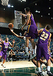 Zach Graham, of the Reno Bighorns, tries to shoot around Los Angeles D-Fenders Gerald Green and Brandon Costner during the men's basketball game, in Reno, Nev., on Friday, Jan. 6, 2012. The De-Fenders won 109-78..Photo by Cathleen Allison