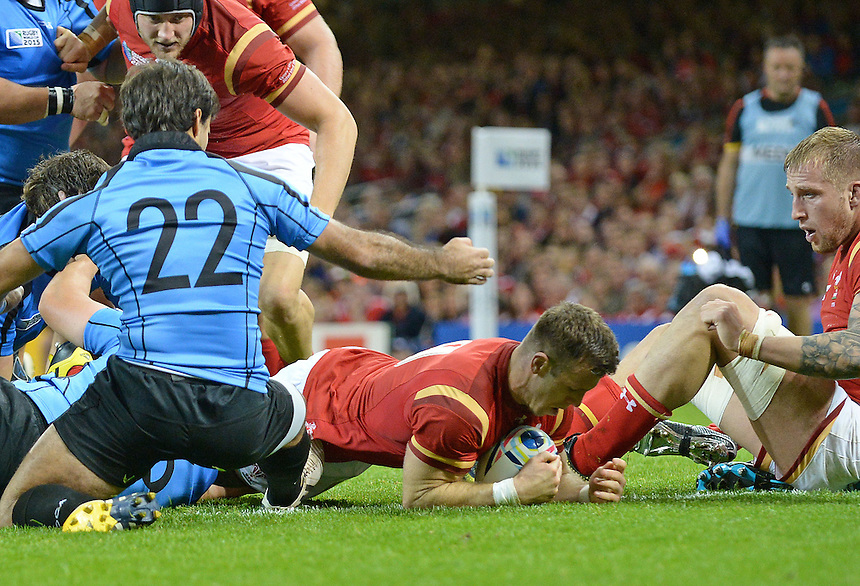Wales' Gareth Davies scores his sides eighth try<br /> <br /> Photographer Ian Cook/CameraSport<br /> <br /> Rugby Union - 2015 Rugby World Cup - Wales v Uruguay - Sunday 20th September 2015 - Millennium Stadium - Cardiff<br /> <br /> &copy; CameraSport - 43 Linden Ave. Countesthorpe. Leicester. England. LE8 5PG - Tel: +44 (0) 116 277 4147 - admin@camerasport.com - www.camerasport.com