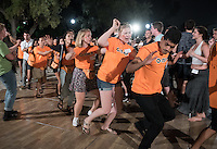Members of the O-Team and incoming Occidental College students, the class of 2020, participate in the annual traditional square dance with the L.A. Wranglers during Orientation, Aug. 25, 2016.<br /> (Photo by Marc Campos, Occidental College Photographer)