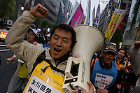 A demo march by left wing groups and anti-nuclear campaigners in Ginza, Tokyo, Japan Sunday November 6th 2011