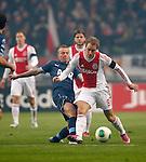 Nederland, Amsterdam, 20 januari 2013.Eredivisie.Seizoen 2012-2013.Ajax-Feyenoord.Christian Eriksen (r.) van Ajax en Jordy Clasie (l.) van Feyenoord strijden om de bal.