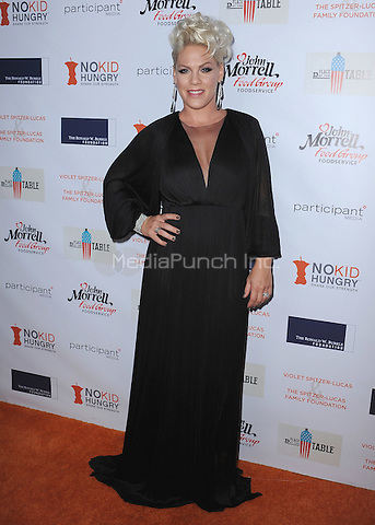 "BEVERLY HILLS, CA - OCTOBER 25:  P!nk at the Los Angeles ""No Kid Hungry"" Dinner at Green Acres on October 25, 2014 in Beverly Hills, California. Credit: PGSK / MediaPunch"