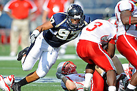9 October 2010:  FIU defensive end Tourek Williams (97) tackles Western Kentucky running back Bobby Rainey (3) for a loss in the second quarter as the FIU Golden Panthers defeated the Western Kentucky Hilltoppers, 28-21, at FIU Stadium in Miami, Florida.