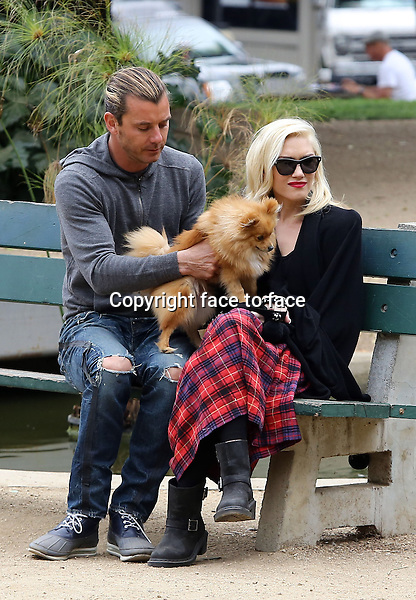 Someone lost his front teeth! Kingston Rossdale shows off his missing front teeth while cruising with his bike in a park in Santa Monica. Meanwhile mommy Gwen Stefani and daddy Gavin Rossdale spent some quiet time with their adorable pooch on a bench. The kids even got icecream in the end! Gwen looked as glamorous as always in her plaid long skirt, biker boots and black wrap. Los Angeles, California on March 20, 2013...Credit: Vida/face to face