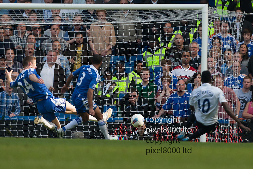 London, UK. Chelsea defender Gary Cahill does well to clear Adebayor's shot off the line during Barclays Premier League fixture Chelsea versus Tottenham Hotspur at Stamford Bridge 24 Mar.  Byline David Fearn Pixel 8000 Ltd