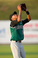 Shortstop Ehire Adrianza #15 of the Augusta GreenJackets settles under a pop fly at Fieldcrest Cannon Stadium July 24, 2009 in Kannapolis, North Carolina. (Photo by Brian Westerholt / Four Seam Images)