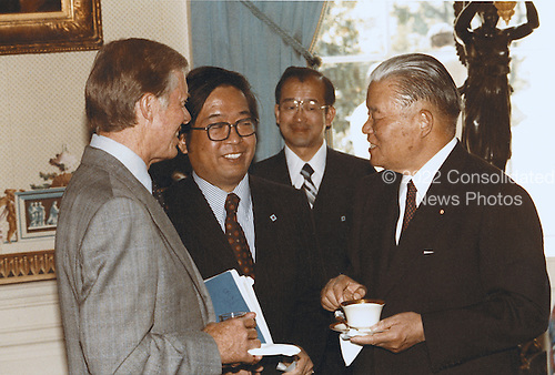 United States President Jimmy Carter, left, enjoys tea in the Blue Room with Prime Minister Masayoshi Ohira of Japan, right, on Wednesday, May 2, 1979.<br /> Mandatory Credit: Bill Fitz-Patrick - White House via CNP