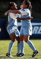 SAN DIEGO, CA - DECEMBER 02, 2012:  Crystal Dunn (19) and Ranee Premji (10) of the University of North Carolina celebrate the third goal against Penn State University during the NCAA 2012 women's college championship match, at Torero Stadium, in San Diego, CA, on Sunday, December 02 2012. Carolina won 4-1.