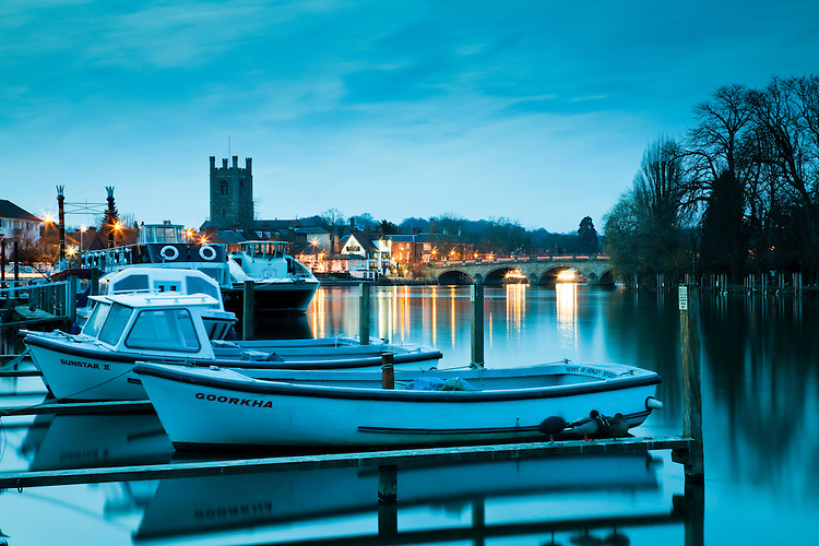 Dusk descendes over Henley on Thames in Oxfordshire from the boat hire bank, Uk
