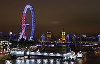 15 July 2016 - London, England - A view of The London Eye on the South Bank in London from Waterloo Bridge which is illuminated in the colours of the French flag to show solidarity with victims of the Bastille Day massacre. Photo Credit: ALPR/AdMedia