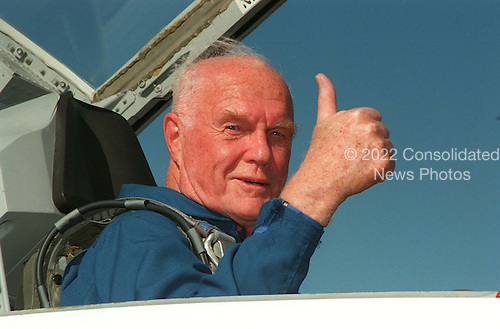 STS-95 Payload Specialist United States Senator John H. Glenn Jr. (Democrat of Ohio) gives a thumbs up on his arrival at Kennedy Space Center's Shuttle Landing Facility aboard a T-38 jet on October 26, 1998. He and other crewmembers will be making final preparations for launch, targeted for liftoff at 2 p.m. on October 29, 1998. The STS-95 mission includes research payloads such as the Spartan solar-observing deployable spacecraft, the Hubble Space Telescope Orbital Systems Test Platform, the International Extreme Ultraviolet Hitchhiker, as well as the SPACEHAB single module with experiments on space flight and the aging process. The mission is expected to last 8 days, 21 hours and 49 minutes, and return to KSC on November 7, 1998. .Credit: NASA via CNP
