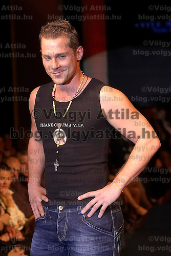 Hungarian celebrity Ferenc Hujber presents collections by Pussy Deluxe and Vive Maria during the opening underwear fashion show of the new event hall called Show-Room in Budapest, Hungary on October 26, 2007. ATTILA VOLGYI