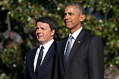 US President Barack Obama (R) and Italian Prime Minister Matteo Renzi (L)participate in an official arrival ceremony on the South Lawn of the White House in Washington DC, USA, 18 October 2016. Later today President Obama and First Lady Michelle Obama will host their final state dinner featuring celebrity chef Mario Batali and singer Gwen Stefani performing after dinner. <br /> Credit: Shawn Thew / Pool via CNP