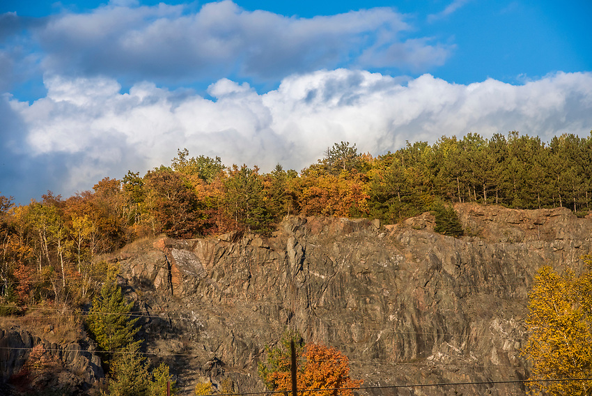 A cliff at a former quarry along the Iron Ore Heritage Trail, a multiuse recreation trail connecting communities in Marquette County on Michigan's Upper Peninsula.