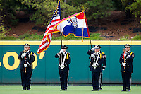 A color guard presents the American Flag and Missouri State Flag for the National Anthem prior to a game between the Northwest Arkansas Naturals and the Springfield Cardinals at Hammons Field on July 30, 2011 in Springfield, Missouri. Springfield defeated Northwest Arkansas 11-5. (David Welker / Four Seam Images)