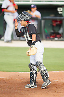 Kannapolis Intimidators catcher Omar Narvaez (10) goes through defensive signs during the game against the Hagerstown Suns at CMC-Northeast Stadium on June 1, 2014 in Kannapolis, North Carolina.  The Suns defeated the Intimidators 11-5 in game two of a double-header.  (Brian Westerholt/Four Seam Images)