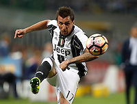 Calcio, Serie A: Inter vs Juventus. Milano, stadio San Siro, 18 settembre 2016.<br /> Juventus&rsquo; Mario Mandzukic kicks the ball during the Italian Serie A football match between FC Inter and Juventus at Milan's San Siro stadium, 18 September 2016.<br /> UPDATE IMAGES PRESS/Isabella Bonotto