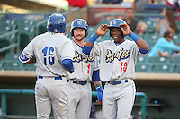 Kyle Garlick (17) and Johan Mieses (18) of the Rancho Cucamonga Quakes greet their teammate Yusniel Diaz (16) after his home run during a game against the Lancaster JetHawks at The Hanger on April 19, 2016 in Lancaster, California. Rancho Cucamonga defeated Lancaster, 10-6. (Larry Goren/Four Seam Images)