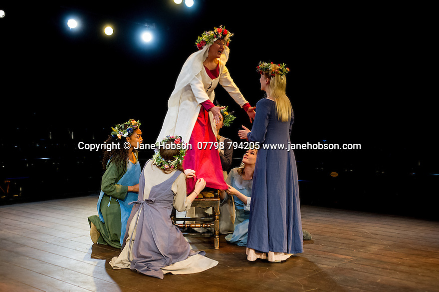 London, UK. 12.06.2014. Bear Trap theatre Company present ENDURING SONG at Southwark Playhouse. Picture shows: Eloise Secker (Jennifer - standing), Leona Allan (Girl), Martha Shrimpton (Maid), Sibylle Bernardin (Sibylle), Ellie Routledge (ensemble) and Emma Ballantyne (Marie). Photograph © Jane Hobson.