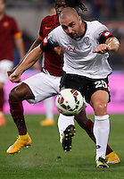 Calcio, Serie A: Roma vs Cesena. Roma, stadio Olimpico, 29 ottobre 2014.<br /> Cesena's Daniele Capelli, foreground, is challenged by Roma's Gervinho during the Italian Serie A football match between AS Roma and Cesena at Rome's Olympic stadium, 29 October 2014.<br /> UPDATE IMAGES PRESS/Isabella Bonotto