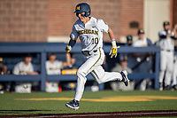 Michigan Wolverines third baseman Blake Nelson (10) sprints towards home plate against the Rutgers Scarlet Knights on April 26, 2019 in the NCAA baseball game at Ray Fisher Stadium in Ann Arbor, Michigan. Michigan defeated Rutgers 8-3. (Andrew Woolley/Four Seam Images)