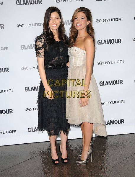 JESSICA BIEL & EVA MENDES .at The Glamour Reel Moments Presented by Hyundai, the Series of Short Films Written and Directed by Women in Hollywood held at The Directors Guild of America in West Hollywood, California, USA, .October 25th 2010..full length strapless cream beige  dress bustier grey gray silver shoes                                          black lace tiered ruffle ruffles peep toe sheer see thru through arm around smiling .CAP/RKE/DVS.©DVS/RockinExposures/Capital Pictures.