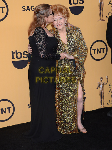25 January 2015 - Los Angeles, California - Debbie Reynolds, Carrie Fisher.<br /> 21st Annual SAG Awards Press Room held at the Los Angeles Shrine Exposition Center. <br /> CAP/ADM/BT<br /> &copy;BT/ADM/Capital Pictures