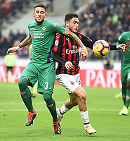 Cristiano Biraghi of Fiorentina and Davide Calabria of AC Milan compete for the ball during the Serie A 2018/2019 football match between AC Milan and ACF Fiorentina at stadio Giuseppe Meazza in San Siro, Milano, December 22, 2018 <br />  Foto Matteo Gribaudi / Insidefoto