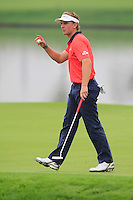Joost Luiten (NED) putts on the 11th green during Friday's Round 2 of the 2014 BMW Masters held at Lake Malaren, Shanghai, China 31st October 2014.<br /> Picture: Eoin Clarke www.golffile.ie