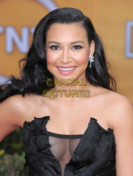 Naya Rivera (wearing Donna Karan).Arrivals at the 19th Annual Screen Actors Guild Awards at the Shrine Auditorium in Los Angeles, California, USA..27th January 2013.SAG SAGs headshot portrait black strapless satin silk corseted  corset sheer accordion pleating decolletage cleavage .CAP/DVS.©DVS/Capital Pictures.