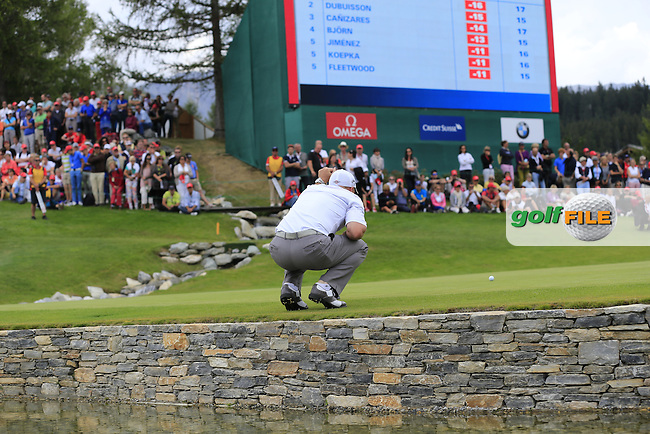 Craig Lee (RSA) lines up his putt on the 18th green during Saturday's Round 3 of the 2013 Omega European Masters held at Crans Montana Golf Club, Crans-Sur-Sierre Switzerland. 7th September 2013.<br /> Picture: Eoin Clarke www.golffile.ie